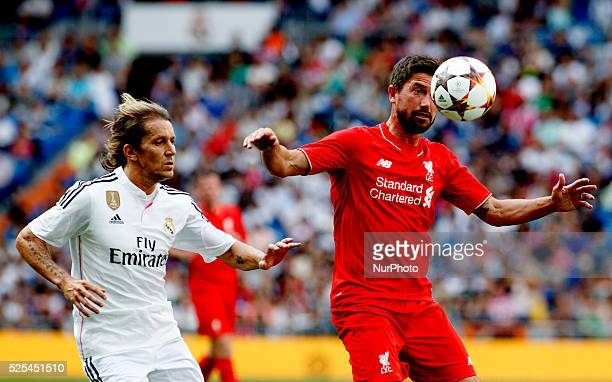 Real Madrid Legends's Spanish Defender Michel Salgado and Liverpol Legends's Australian forward Harry Kewell during the Corazon classic match 2015...