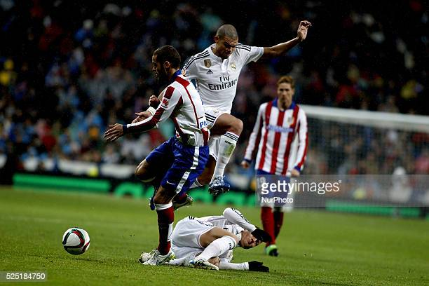 Real Madrid's Portuguese Defender Pepe during and Atletico de Madrid's Spanish midfielder Mario Suarez the Spanish Kingscup 2014/15 match between...