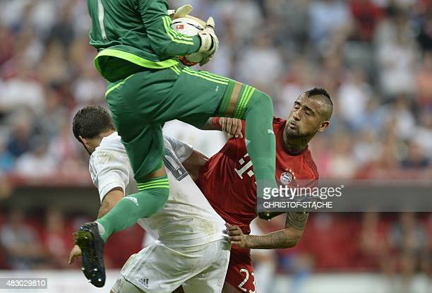 Madrid's defender Nacho Madrid's Costa Rica's goalkeeper Keylor Navas and Bayern Munich's Chilian midfielder Arturo Vidal vie for the ball during the...