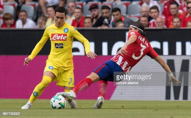 Madrid's Filipe Luis and Napoli's Jose Callejon vie for the ball during the Audi Cup semifinal match pitting Atletico Madrid vs SSC Napoli in the...