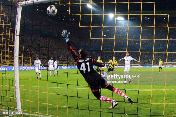 Madrid's goalkeeper Diego Lopez can n ot save the ball for the 31 during the UEFA Champions League semi final first leg soccer match between Borussia...