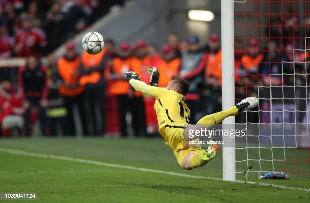 Madrid's goalkeeper Jan Oblak jumps to the ball during the Champions League semifinal second leg soccer match between Bayern Munich and Atletico...