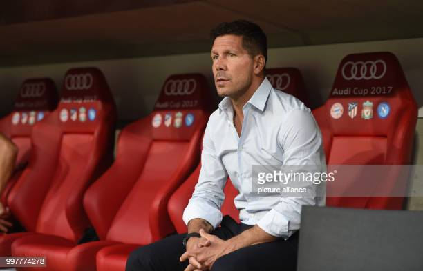 Madrid's manager Diego Simeone on the bench during the Audi Cup final soccer match between Atletico Madrid and FC Liverpool in the Allianz Arena in...