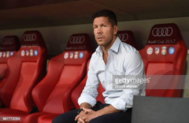 Madrid's manager Diego Simeone sits on the bench during the Audi Cup final soccer match between Atletico Madrid and FC Liverpool in the Allianz Arena...