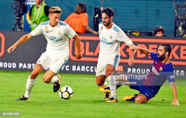 Madrid's Marcos Llorente and Isco fights for the ball against Real Madrid Arda Turna during the second half of the International Champions Cup soccer...