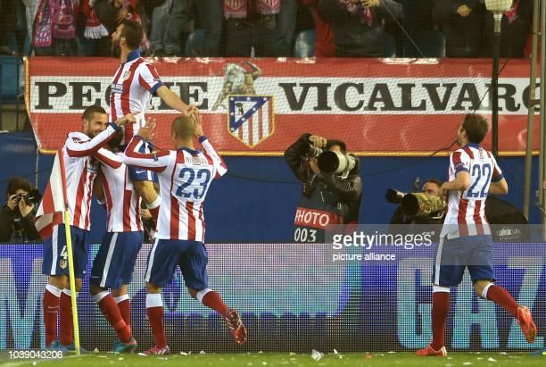 Madrid's Mario Suárez celebrates after scoring the 1-0 goal with team mates Jesus Gamez, Arda Turan, Miranda and Cani during the UEFA Champions...
