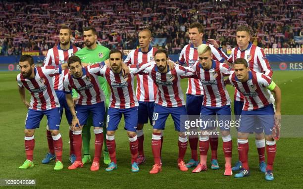 Madrid's Mario Suárez , goalkeeper Miguel Angel Moya, Miranda, Mario Mandzukic, José Maria Gimenez and Arda Turan , Cani, Jesus Gamez, Juanfran,...