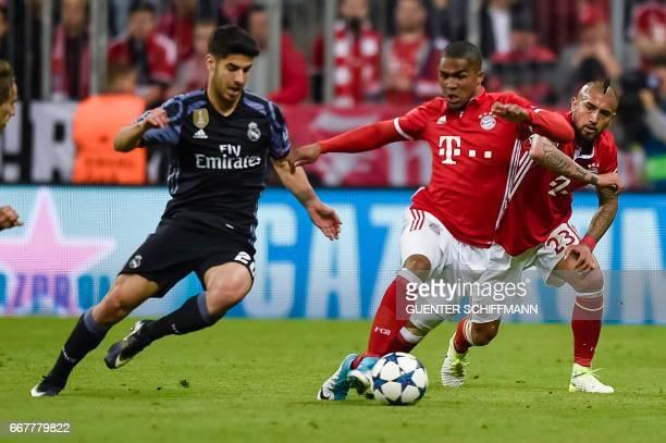 Madrid's Spanish midfielder Marco Asensio and Bayern Munich's Brazilian midfielder Douglas Costa and Bayern Munich's Chilean midfielder Arturo Vidal...