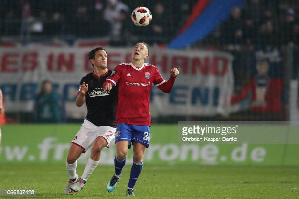 Mads Albaek of Kaiserslautern challenges Luca Marseiler of SpVgg Unterhaching during the 3 Liga match between SpVgg Unterhaching and 1 FC...