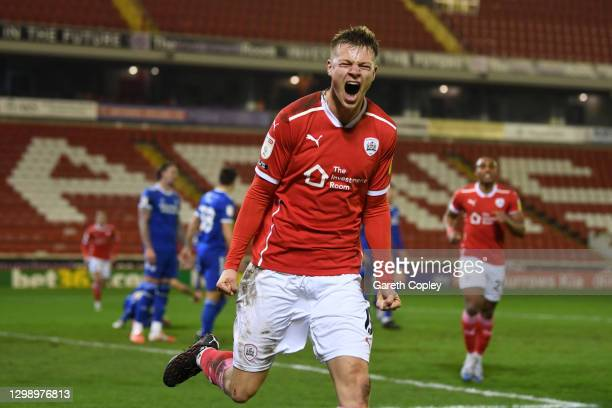Mads Andersen of Barnsley celebrates after scoring their sides first goal during the Sky Bet Championship match between Barnsley and Cardiff City at...