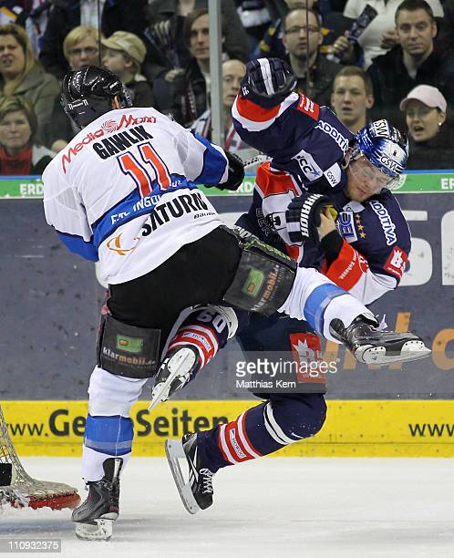Mads Christensen of Berlin is attacked by Christoph Gawlik of Ingolstadt during the third DEL quarter final playoff game between EHC Eisbaeren Berlin...