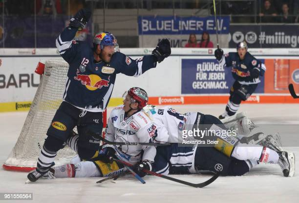 Mads Christensen of EHC Red Bull Muenchen celebrates his team's fourth goal during the DEL Playoffs Final Match 7 between EHC Red Bull Muenchen and...