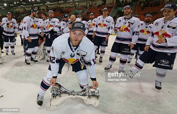Mads Christensen of Muenchen poses with the trophy after winning the DEL playoffs final game four between Grizzlys Wolfsburg and Red Bull Muenchen at...