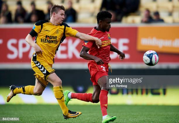 Mads Dohr Thychosen of AC Horsens and Godsway Donyoh of FC Nordsjalland compete for the ball during the Danish Alka Superliga match between AC...