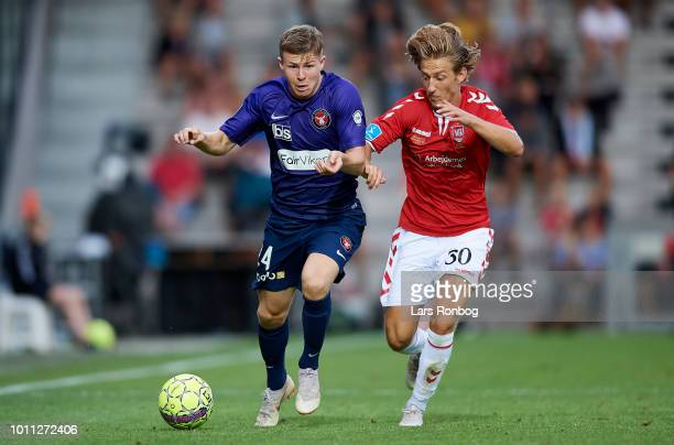 Mads Dohr Thychosen of FC Midtjylland and Arbnor Mucolli of Vejle Boldklub compete for the ball during the Danish Superliga match between Vejle...