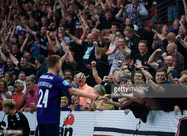 Mads Dohr Thychosen of FC Midtjylland celebrates with the fans after scoring their third goal during the Danish Superliga match between Vejle...