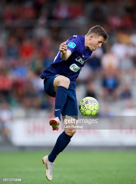 Mads Dohr Thychosen of FC Midtjylland controls the ball during the Danish Superliga match between Vejle Boldklub and FC Midtjylland at Vejle Stadion...