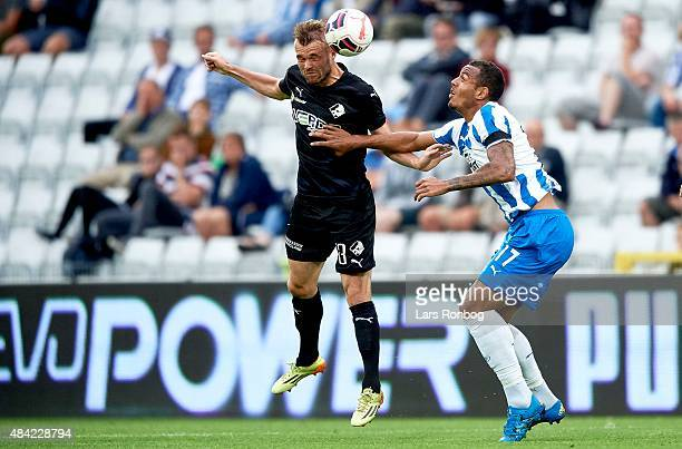 Mads Fenger of Randers FC and Kenneth Zohore of OB Odense compete for the ball during the Danish Alka Superliga match between OB Odense and Randers...