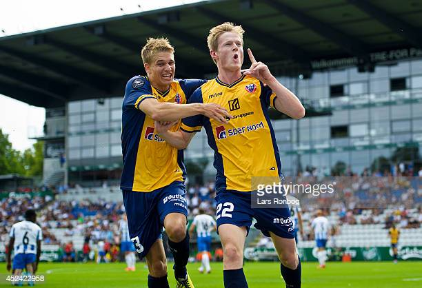 Mads Hvilsom and Jesper Boge of Hobro IK celebrate after scoring their first goal during the Danish Superliga match between OB Odense and Hobro IK at...