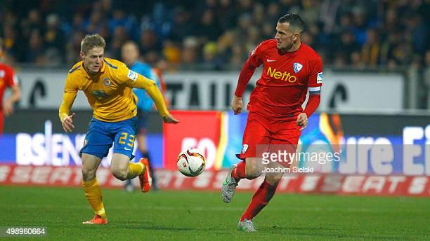 Mads Hvilsom of Braunschweig challenges Patrick Fabian of Bochum during the Second Bundesliga match between Eintracht Braunschweig and VfL Bochum at...