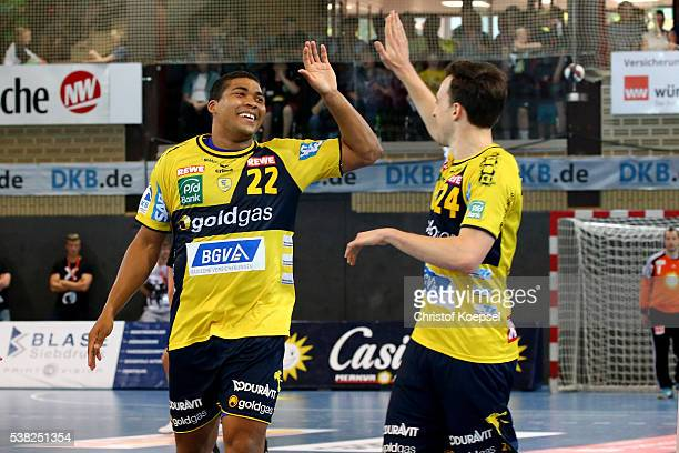 Mads Mensah Larsen and Patrick Groetzki of RN Loewen celebrate a goal during the DKB Handball Bundesliga match between TuS NLuebbecke and RN Loewen...