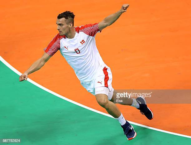 Mads Mensah Larsen of Denmark celebrates his goal in the first half against Tunisia on Day 4 of the Rio 2016 Olympic Games at the Future Arena on...