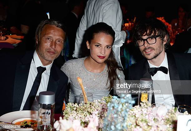 Mads Mikkelsen Alicia Vikander and guest attend the Gala Dinner for amfAR's 20th Annual Cinema Against AIDS at Hotel du CapEdenRoc on May 23 2013 in...