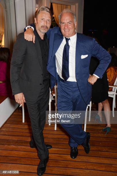 Mads Mikkelsen and Charles Finch attend the annual Charles Finch Filmmakers Dinner during the 67th Cannes Film Festival at Hotel du CapEdenRoc on May...