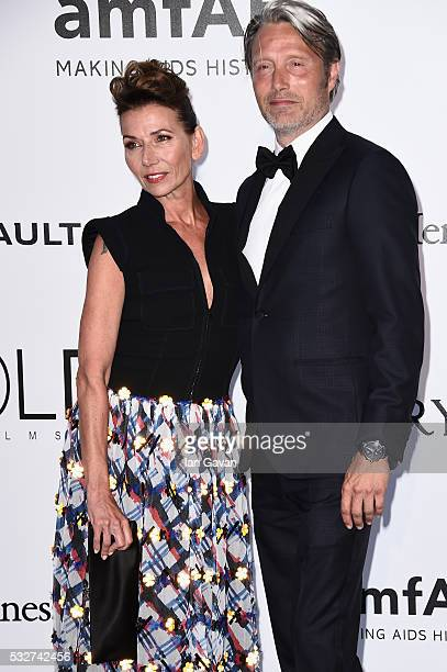 Mads Mikkelsen and Hanne Jacobsen arrive at amfAR's 23rd Cinema Against AIDS Gala at Hotel du CapEdenRoc on May 19 2016 in Cap d'Antibes France