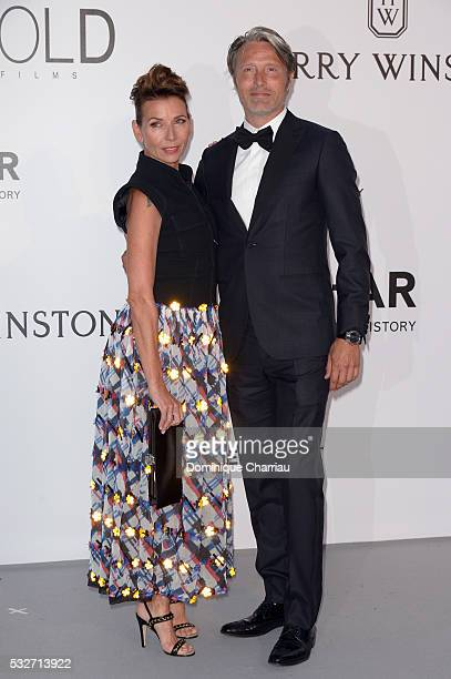 Mads Mikkelsen and Hanne Jacobsen attend the amfAR's 23rd Cinema Against AIDS Gala at Hotel du CapEdenRoc on May 19 2016 in Cap d'Antibes France