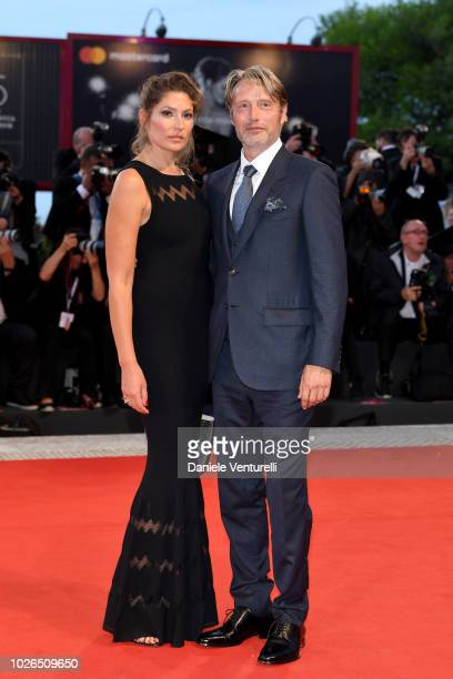 Mads Mikkelsen and Hanne Jacobsen walks the red carpet ahead of the 'At Eternity's Gate' screening during the 75th Venice Film Festival at Sala...