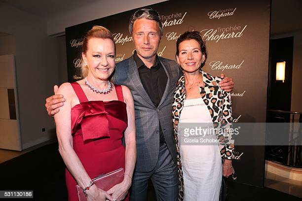Mads Mikkelsen and his wife Hanne Jacobsen and Caroline Scheufele arrive at the Chopard Trophy Ceremony at the annual 69th Cannes Film Festival at...