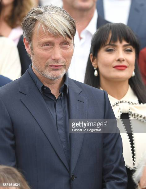 Mads Mikkelsen and Salma Hayek attend the 70th Anniversary Photocall during the 70th annual Cannes Film Festival at Palais des Festivals on May 23...
