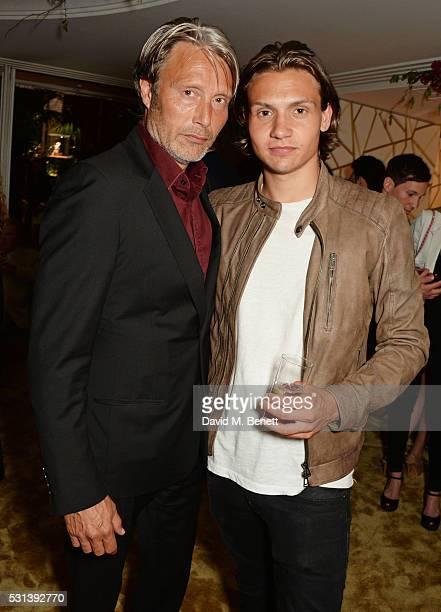 Mads Mikkelsen and son Carl Jacobsen Mikkelsen attend the Chopard x Annabel's Cannes party on May 14 2016 in Cannes France