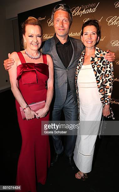 Mads Mikkelsen Hanne Jacobsen and Caroline Scheufele arrive at the Chopard Trophy Ceremony at the annual 69th Cannes Film Festival at Hotel Martinez...
