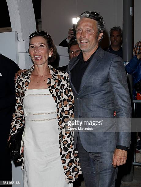 Mads Mikkelsen Hanne Jacobsen attends a Vanity Fair dinner at the Tetou restaurant during the 69th Annual Cannes Film Festival on May 12 2016 in...
