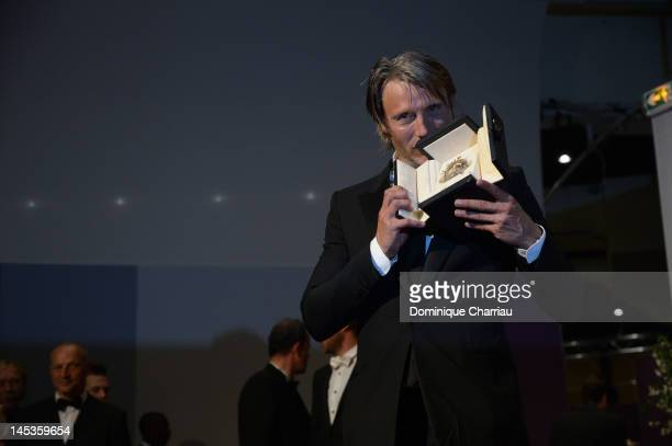 Mads Mikkelsen poses with his Best Actor Award for his role in 'The Hunt' at the Winners Photocall during the 65th Annual Cannes Film Festival at...