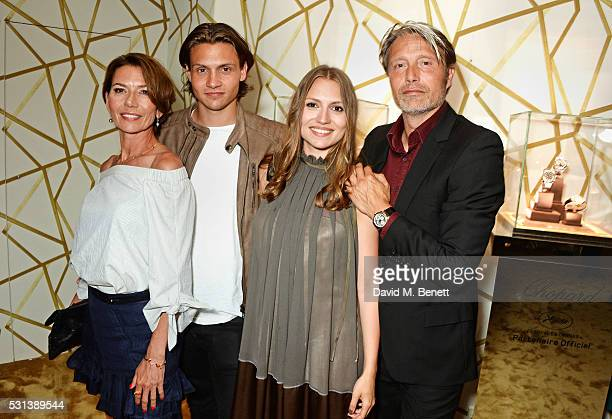 Mads Mikkelsen poses with wife Hanne Jacobsen and children Carl Jacobsen Mikkelsen and Viola Jacobsen Mikkelsen attend the Chopard x Annabel's Cannes...