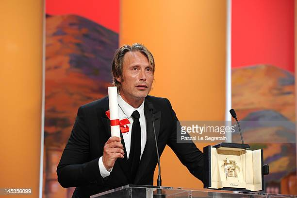 Mads Mikkelsen receives Best Actor for his role in The Hunt onstage at the Closing Ceremony during the 65th Annual Cannes Film Festival on May 27...