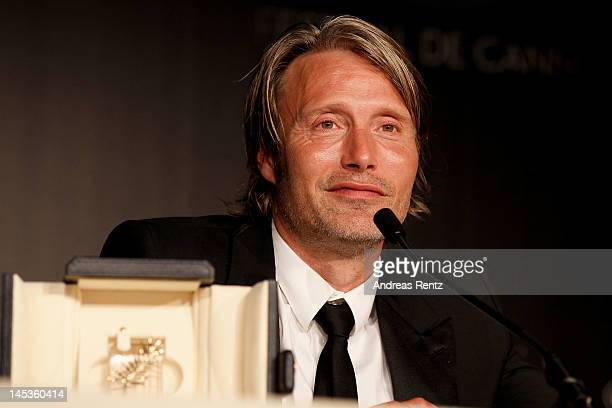 Mads Mikkelsen with his Best Actor Award for his role in 'The Hunt' attends the Winners Press Conference during the 65th Annual Cannes Film Festival...