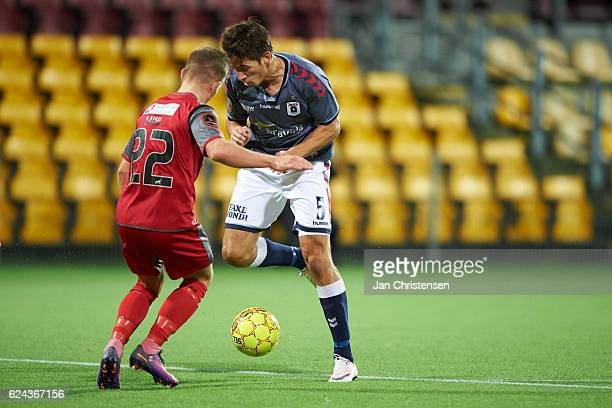 Mads Pedersen of FC Nordsjalland and Alexander Juel Andersen of AGF Arhus compete for the ball during the Danish Alka Superliga match between FC...