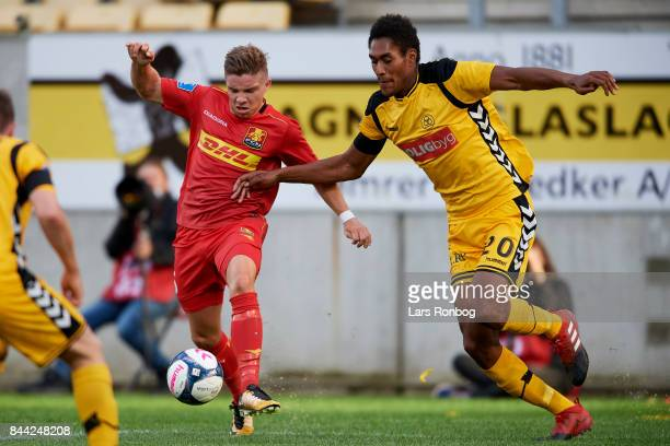 Mads Pedersen of FC Nordsjalland and Mikkel Qvist of AC Horsens compete for the ball during the Danish Alka Superliga match between AC Horsens and FC...