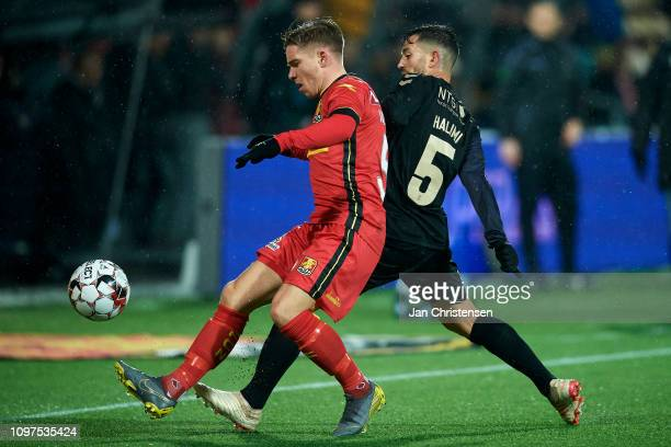 Mads Valentin Pedersen of FC Nordsjalland and Besar Halimi of Brondby IF compete for the ball during the Danish Superliga match between FC...