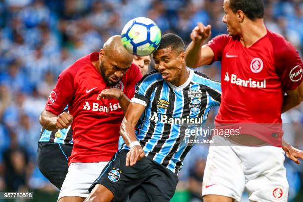 Madson of Gremio battles for the ball against Rodrigo Moledo of Internacional during the match between Gremio and Internacional part of Campeonato...