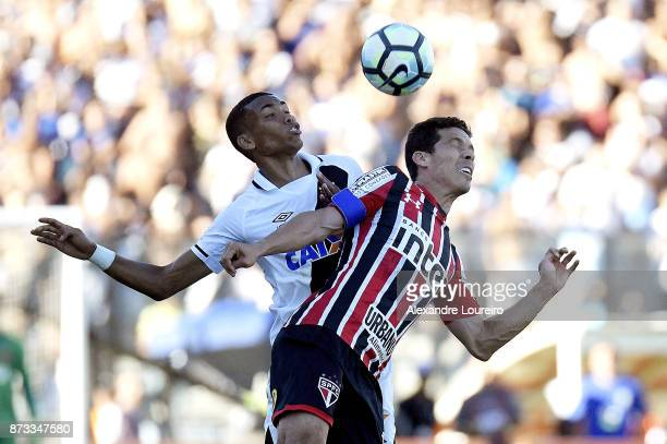 Madson of Vasco da Gama struggles for the ball with Hernanes of Sao Paulo during the match between Vasco da Gama and Sao Paulo as part of Brasileirao...
