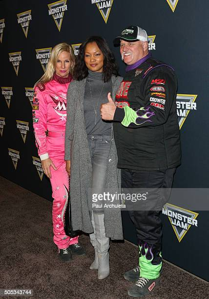 Madusa Garcelle Beauvais and Dennis Anderson attend Monster Jam at Angel Stadium of Anaheim on January 16 2016 in Anaheim California
