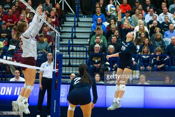 Mady Arles of Emory University reaches to spike the ball against Calvin College during the Division III Women's Volleyball Championship held at the...