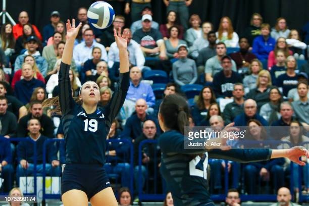 Mady Arles of Emory University sets the ball during the Division III Women's Volleyball Championship held at the AJ Palumbo Center on November 17...
