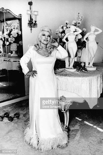 Mae West, at 85 years old, takes a statuesque pose.