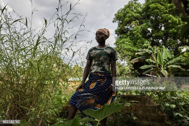 MaeJean Singbe who lost her daughter father and uncle to the Ebola virus poses in Mawah on November 29 2017 The devastating effect of Ebola on...